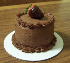 baby cake with chocolate buttercream frosting