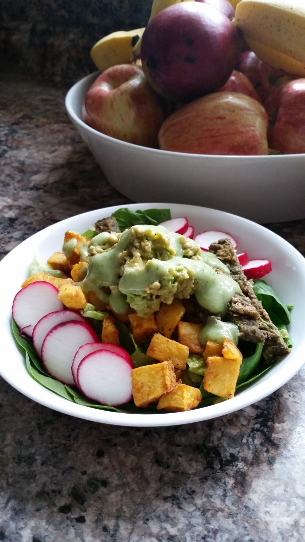 Gluten free and vegan salad with veggie burger patty. - thesimplehive.com
